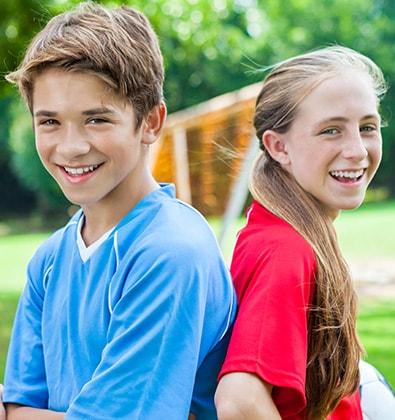 Teens Holding Folders