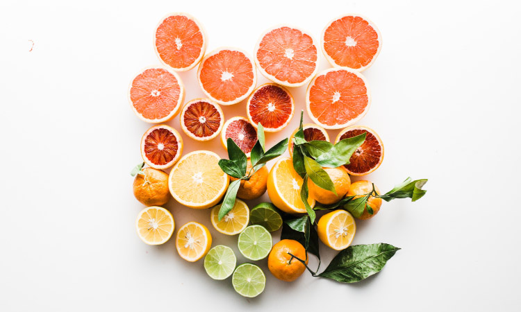 Aerial view of a cluster of acidic grapefruits, oranges, lemons, and limes