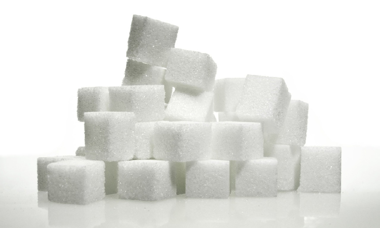 stacked sugar cubes on white background